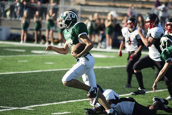 Record-Eagle/Keith King<br /> Traverse City West's Isaiah Hackney runs the ball on his way to scoring a touchdown against Essex Friday, September 10, 2010 at Thirlby Field.
