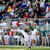 Record-Eagle/Jan-Michael Stump<br /> Traverse City West's Geordon Carter (34) makes a leaping catch in the first quarter of Friday's win over Cadillac.