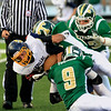 Record-Eagle/Jan-Michael Stump<br /> Cadillac's Patrick Briggs (20)  gets tackled by Traverse City West's Dustin Tucker (9), and Storm Eagle (85) in the first quarter of Friday's game.