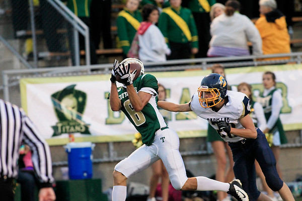 Record-Eagle/Jan-Michael Stump<br /> Traverse City West's Tyler Johnson (6) pulls in a touchdown pass in front of Cadillac's Patrick Briggs (20) in the second quarter of Friday's game.