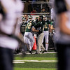 Record-Eagle/Jan-Michael Stump<br /> Traverse City West coach Tim Wooer congratulates Griffin Forrester (42) after his second quarter touchdown run in Friday's win over Cadillac.