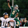 Record-Eagle/Jan-Michael Stump<br /> Traverse City West's Tyler Johnson (6) and Geordon Carter (34) celebrate Johnson's second quarter touchdown in Friday's win over Cadillac.