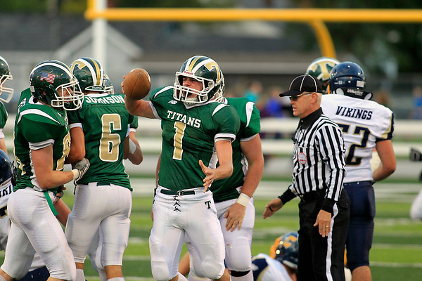 Record-Eagle/Jan-Michael Stump<br /> Traverse City West' Zack McGuire (1) celebrates his first  quarter interception in Friday's win over Cadillac.