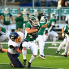 Record-Eagle/Jan-Michael Stump<br /> Cadillac's Riley Norman (77) tackles Traverse City West's Griffin Forrester (42) in the first quarter of Friday's game.