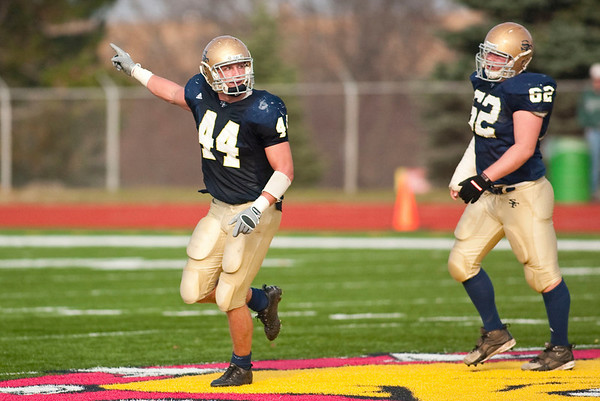 Record-Eagle/Jan-Michael Stump<br /> Traverse City St. Francis linebacker Max Bullough celebrates a play in the first half of Saturday's state semifinal win over Ravenna.