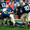 Record-Eagle/Jan-Michael Stump<br /> Traverse City St. Francis players tackle  Ravenna quarterback Ryan Hogan (7) in the first half of Saturday's state semifinal win.