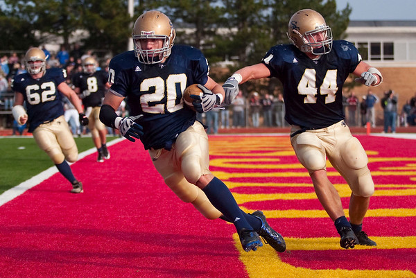 Record-Eagle/Jan-Michael Stump<br /> Traverse City St. Francis defensive back Matt Zakrzewski (20) intercepts a Ravenna endzone pass with linebacker Max Bullough (44) in the second quarter of Saturday's game.