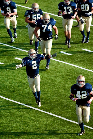 Record-Eagle/Jan-Michael Stump<br /> Traverse City St. Francis fullback Luke Popp (2) and teammates celebrate after Joey Kerridge's first quarter touchdown in Saturday's win over Ravenna.