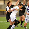 _S0429SOCCER4_.jpg  S0429SOCCER4<br /> <br /> Monarch's #8, Phoebe Szeton and Boulder's #15, Sarah Hagerty get tangled.<br /> <br /> Photo by: Jonathan Castner