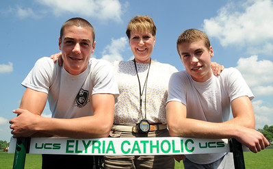 Evan Foreman, left, Kari Foreman and Patrick Foreman of Elyria Catholic track prepare for the state tournament.  Evan in 110 meter hurdles, and Patrick in the 3200 meter relay.   Steve Manheim