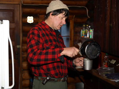 Paul making tea in special edition Titanium cup that's custom laser scribed with BWAC logo, his name and year of service.  Frostbite is a small price to pay for precious metal.