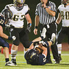 S0921LEGACY5<br /> Legacy's #47, Conner Ayers recovers a Ft. Colins fumble.<br /> <br /> Photo by: Jonathan Castner