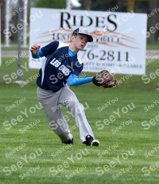 -Messenger photo by Britt Kudla<br /> Jase Nekvinda of Fort Dodge Legends 12U catches a pop fly against Ankeny Outlaws during Taco Tico Throwdown on Saturday at Rogers Park