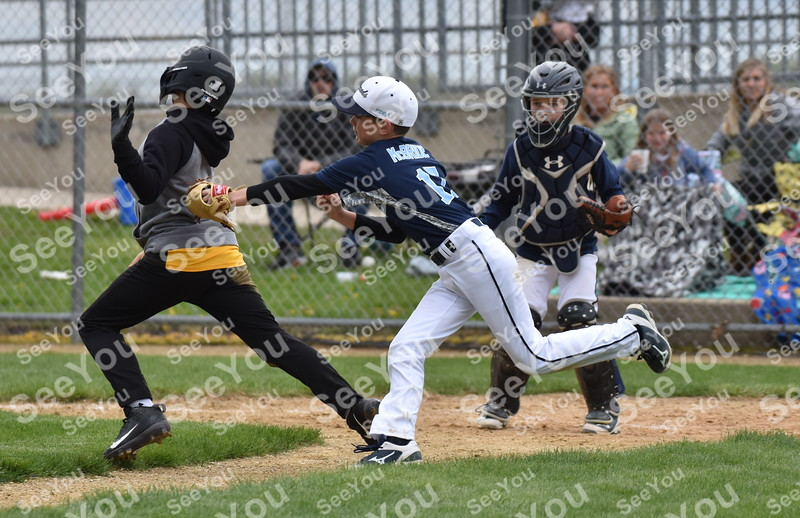 -Messenger photo by Britt Kudla<br /> Tru McBride of Fort Dodge Legends 10U tags Clear Lake during Taco Tico on Saturday at Rogers Park