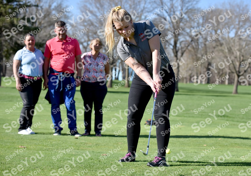 -Messenger photo by Britt Kudla <br /> Foreign Exchange student from the Netherlands chip a shot on to the green while her family (left to right) Miranda Treep (mother), Gaby Treep (Father), and grandmother Margriet Van Bramm watches from behind at Fort Dodge Country Club on Tuesday