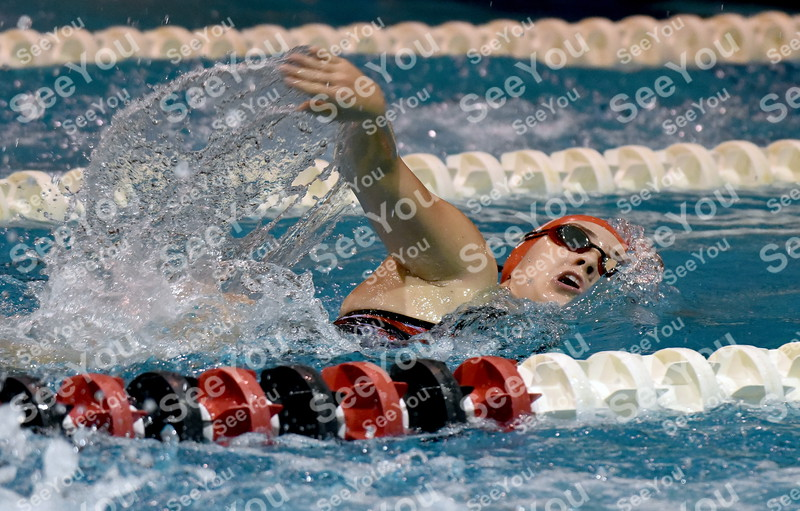 -Messenger photo by Britt Kudla<br /> Cayla Steinman of Algona compete in the 100 Yard Freestyle against Fort Dodge on Thursday