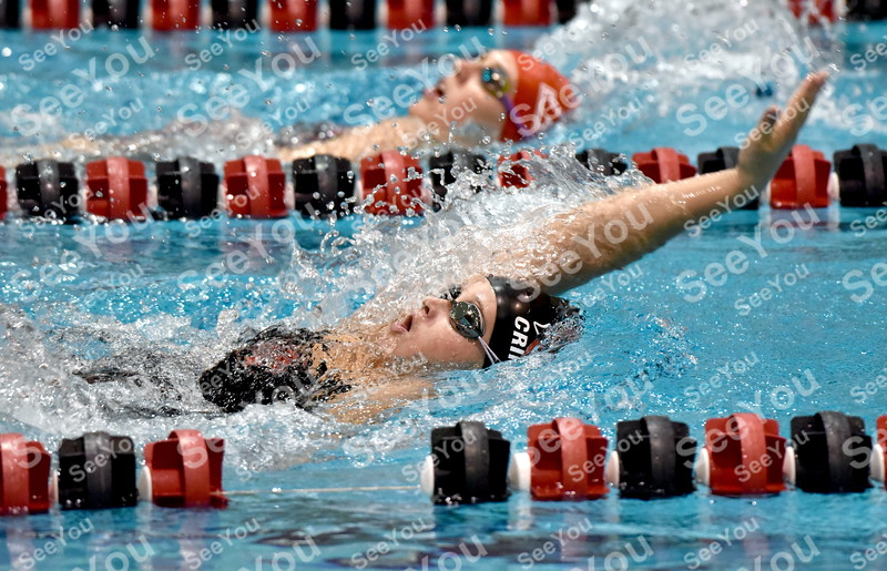 -Messenger photo by Britt Kudla<br /> Sydney Crimmins of Fort Dodge compete during the 100 Yard Backstroke on Thursday