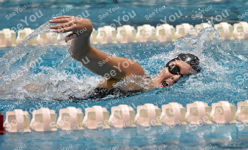 -Messenger photo by Britt Kudla<br /> Madigan Peimann of Fort Dodge compete during girls 500 yard freestyle against Carroll and Spencer on Thursday