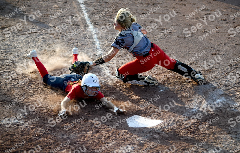 -Messenger photo by Britt Kudla<br /> Tristin Doster of Fort Dodge tags Ballard Abby Husak during Dodgers Invitational on Friday at Rogers Park