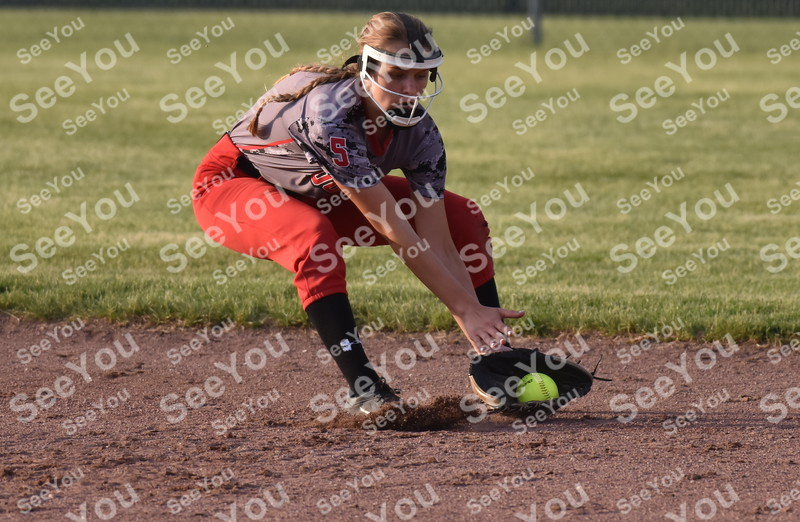 -Messenger photo by Britt Kudla<br /> Aubrey Davis of Fort Dodge picks up a grounder against Ballard on Friday at Rogers Park
