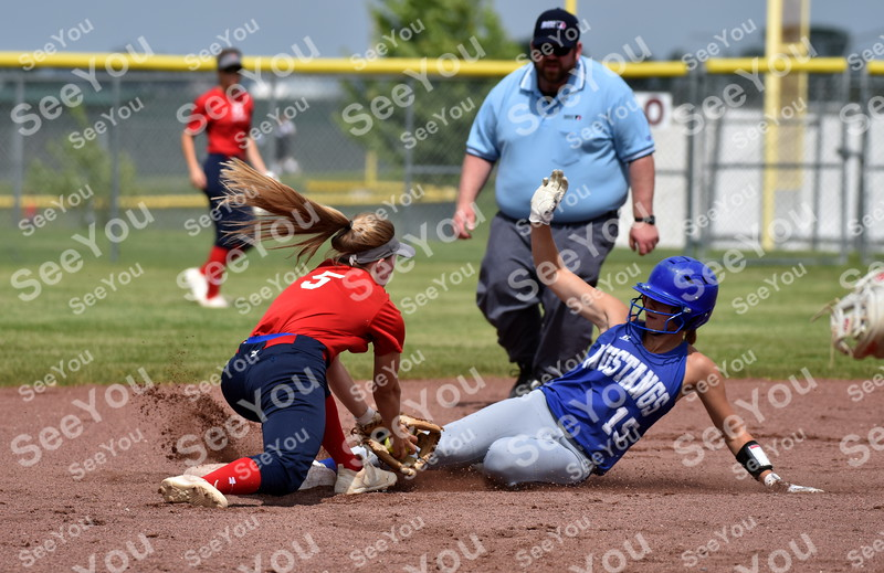 -Messenger photo by Britt Kudla<br /> Olivia Larsen of Newell-Fonda slides around Ballard Isabell Hobbs during Fort Dodge Invitational on Friday at Rogers Park