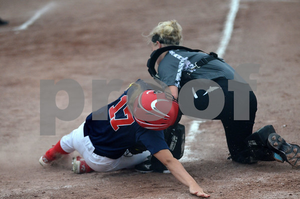 -Messenger photo by Britt Kudla<br /> Molly Mathes (12) of Fort Dodge makes the stop at home against Marshalltown's McKenna Major during the Dodger 2-0 victory on Monday