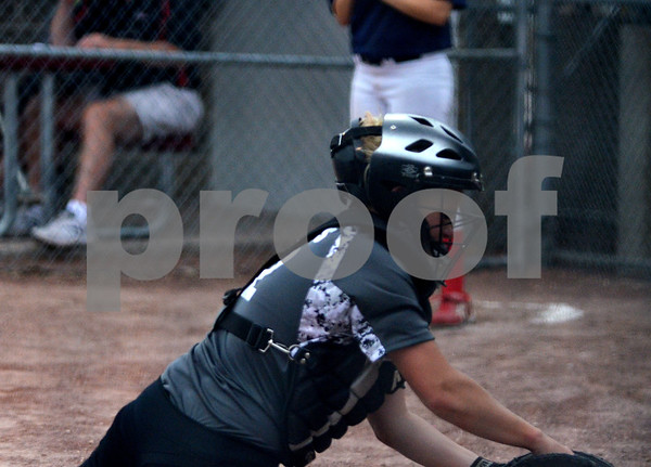 -Messenger photo by Britt Kudla<br /> Molly Mathes of Fort Dodge makes a diving catch in the seventh inning against Marshalltown on Monday at Roger Park