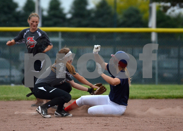-Messenger photo by Britt Kudla<br /> Lani Van Zyl of Fort Dodge gets the final out of the game against Marshalltown on Monday. Dodger claim victory over the Bobcats 2 to 0.