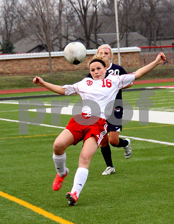 messenger photo by Britt Kudla<br /> Hailee Richardson of Fort Dodge stretches for the ball during Monday game, against Sioux City.