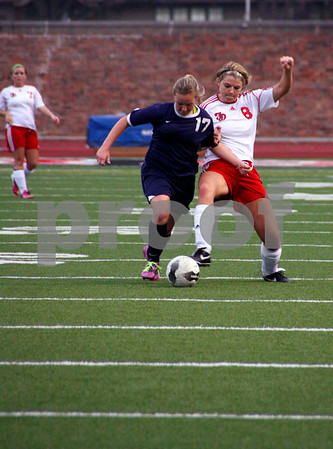 messenger photo by Britt Kudla<br /> Madeline Westerhoff of Fort Dodge fights for the ball against Sioux City Monday night.