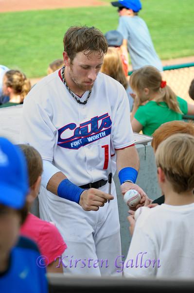 #14 Jon Dziomba autographs a baseball during the game break.