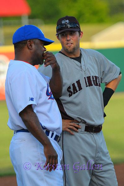Manager and 3rd base coach Curtis Wilkerson chatting up the San Angelo 3rd baseman.