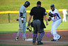3rd Baseman Brandon Jones argues his case to the umpire that the runner was out, after the umpire called him safe.