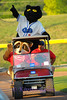 The Fort Worth Cat mascot, Dodger and the Omni Bank Raccoon get a ride around the stadium.
