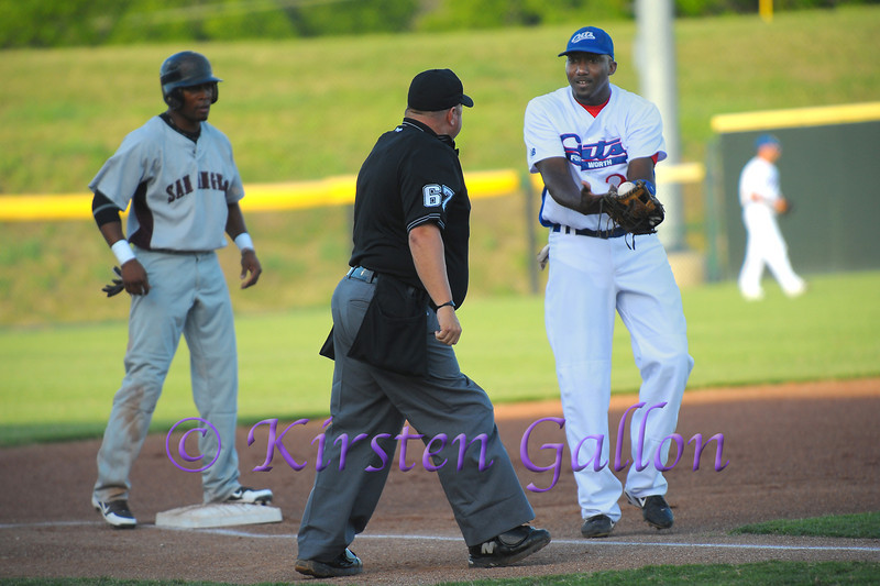 3rd Baseman Brandon Jones trying to convince the umpire the runner was out.