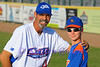 Cats bullpen coach Jeff Russell with a young baseball fan.
