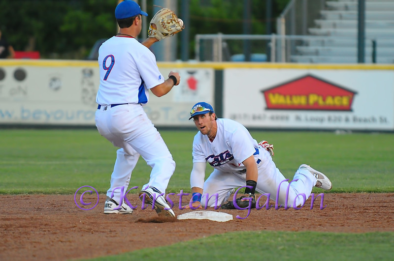 After catching the short flip from #14 Jon Dziomba, #9 shortstop Shelby Ford turns for the double play.