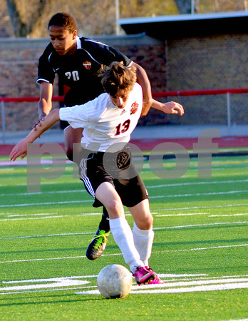 - Messenger photo by Britt Kudla       <br /> Fort Dodge's Alexander Jackson fights for control of the ball against Ames on Friday at Dodger's stadium