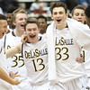 DeLaSalle High School basketball players Samm Jones, left, Austin McGeheran, Eli Brimacomb, Jeffery Daubanton, Gabe Kalscheur and Sacar Anim begin the celebration at the end of their 82-64 win over St. Paul Johnson in the Class AAA boys basketball finals March 14 at Target Center in Minneapolis. It was the fourth consecutive state title for the Islanders, who finished the season with a record of 27-4. Brimacomb, Daubanton and Anim are seniors, Jones and McGeheran are juniors and Kalscheur is a freshman. Dave Hrbacek/The Catholic Spirit