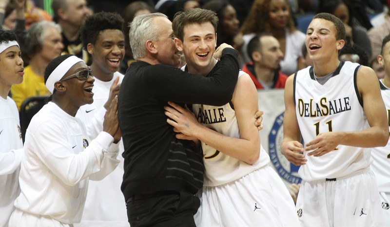 DeLaSalle head coach Dave Thorson celebrates with his players as the final seconds tick away. Dave Hrbacek/The Catholic Spirit