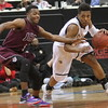 DeLaSalle senior guard Jarvis Johnson fends off pressure from Johnson's Malik Jones. Dave Hrbacek/The Catholic Spirit