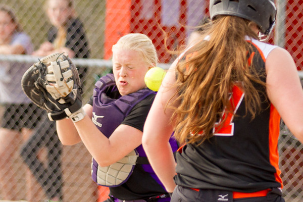 Record-Eagle/Brett A. Sommers Frankfort's Keziah Stockdale is hit in the face on a throw from the outfield as Kingsley's Alison Folkersma scores during Tuesday's softball doubleheader. Frankfort won the first game 9-0, and Kingsley won the second 10-4.