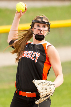 Record-Eagle/Brett A. Sommers Kingsley's Haven Robinson makes a throw from third base during Tuesday's softball doubleheader against Frankfort. Frankfort won the first game 9-0, and Kingsley won the second 10-4.
