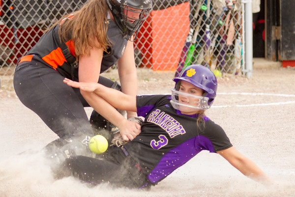 Record-Eagle/Brett A. Sommers Frankfort's Bre Dawe slides under the tag attempt of Kingsley's Alison Folkersma during Tuesday's softball doubleheader. Frankfort won the first game 9-0, and Kingsley won the second 10-4.