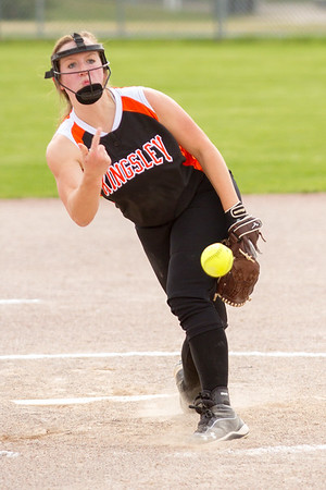Record-Eagle/Brett A. Sommers Kingsley's McKenna Musser hurls a pitch during Tuesday's softball doubleheader against Frankfort. Frankfort won the first game 9-0, and Kingsley won the second 10-4.