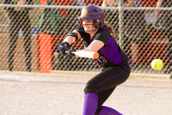 Record-Eagle/Brett A. Sommers Frankfort's Alyssa Dawe attempts to bunt during Tuesday's softball doubleheader against Kingsley. Frankfort won the first game 9-0, and Kingsley won the second 10-4.