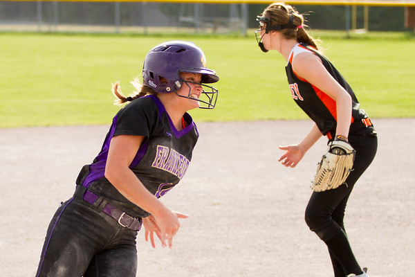 Record-Eagle/Brett A. Sommers Frankfort's Natalie Bigley rounds third base during Tuesday's softball doubleheader against Kingsley. Frankfort won the first game 9-0, and Kingsley won the second 10-4.