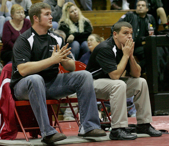 E.L. Hubbard for the DDN<br /> Carlisle coaches Daryl Clark and Josh Laughlin watch their wrestlers during the 2008 nGrudge Match with Franklin at Carlisle High School Wednesday, December 10, 2008.