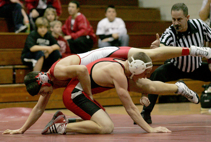 E.L. Hubbard for the DDN<br /> Carlisle's Cody Washington defeats Franklin's Austin Robinson by pin during the 2008 Grudge Match at Carlisle High School Wednesday, December 10, 2008.