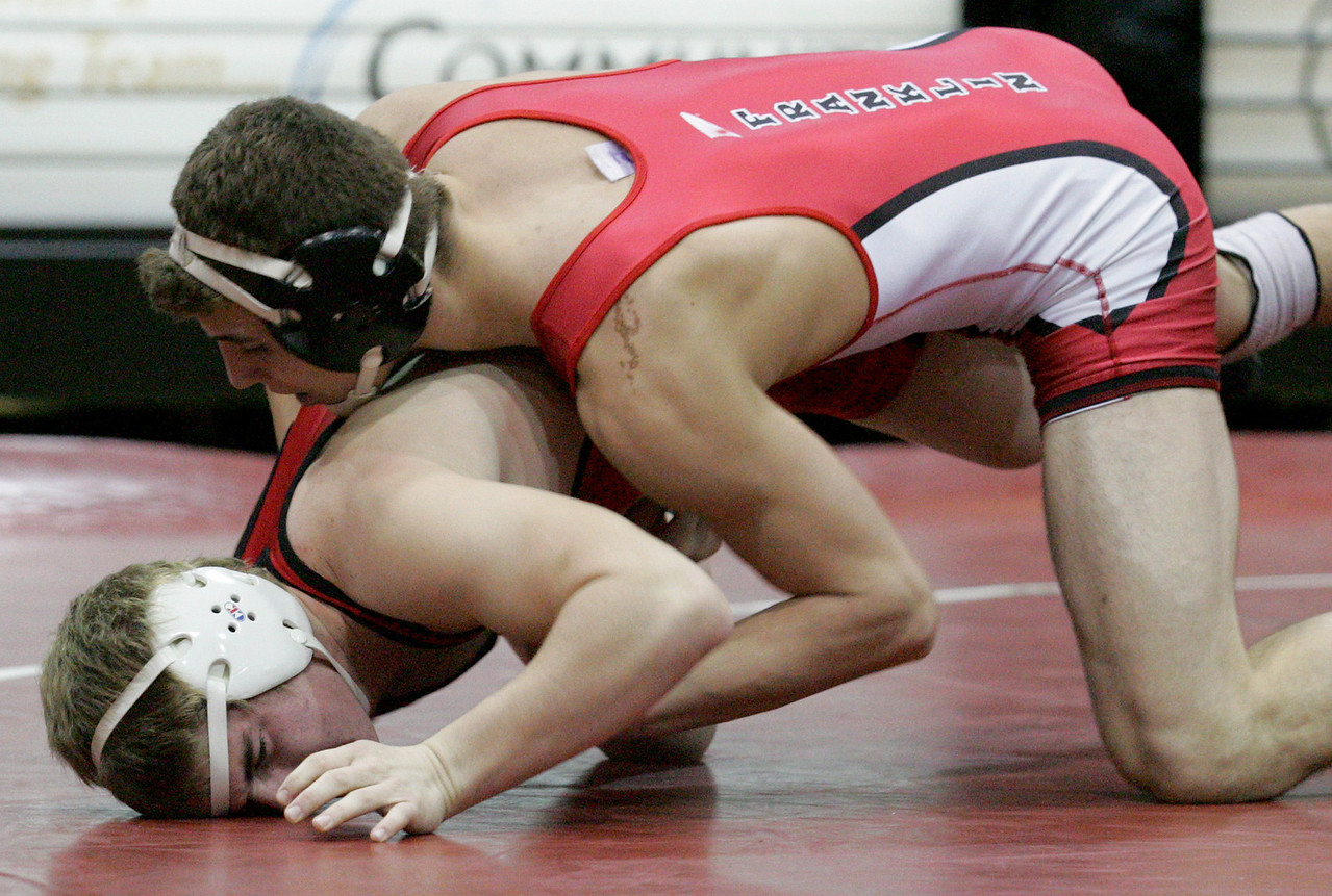 E.L. Hubbard for the DDN<br /> Carlisle's Dusty Laughlin wrestles Franklin's Eric Hildebrand during the 2008 Grudge Match at Carlisle High School Wednesday, December 10, 2008. Hildebrand won by pin.